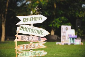 wooden pointer for wedding ceremony in yard